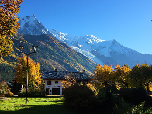 autumn colors in valley and snow covered mountans seen during dog travel French Alps