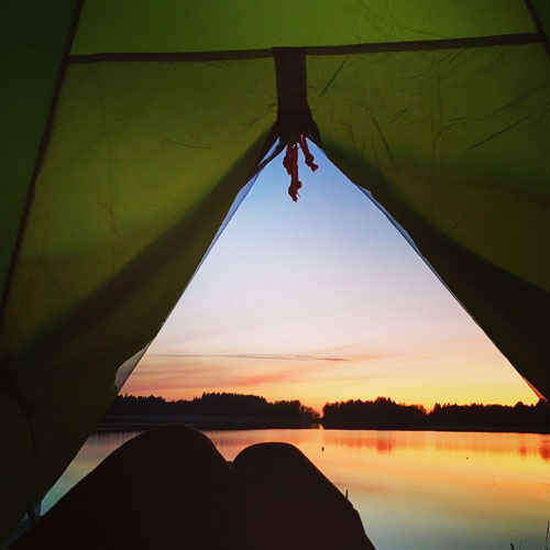 Tent and sunset during dog travel Finland