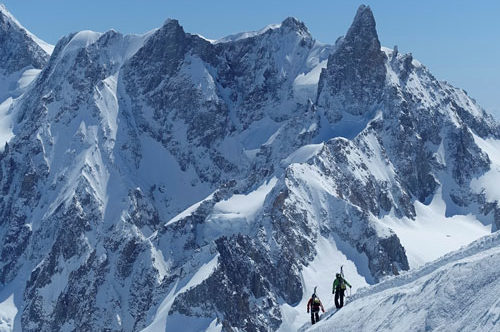 Climbers and mountains seen during dog travel French Alps