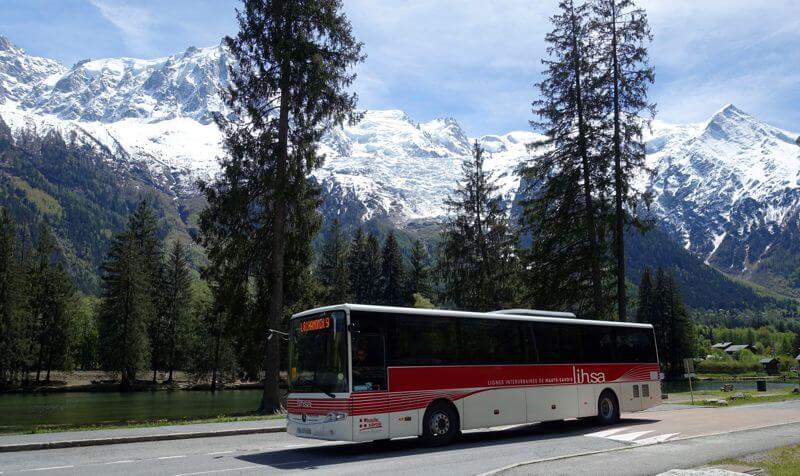 Bus in front of mountains during dog travel French Alps