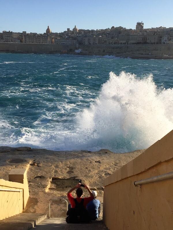 waves splashing high durig dog travel Malta