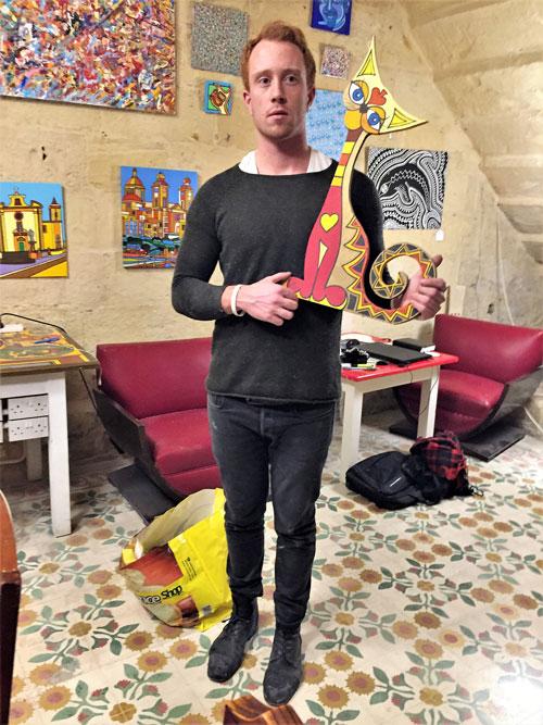 Man showing art cat, Cocohub friends