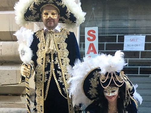 Two people dressed up in beautiful historic costumes on Malta