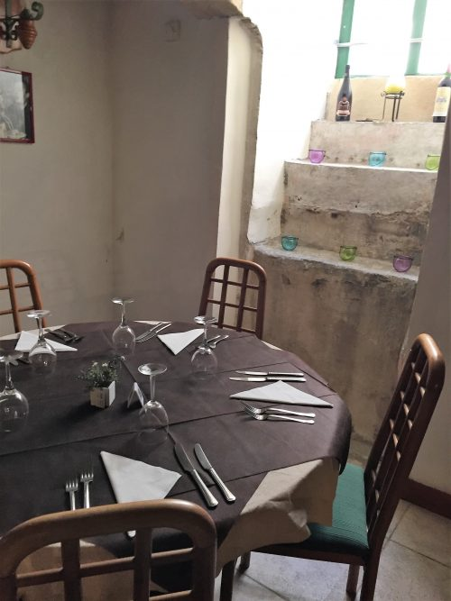 Set table in quaint restaurant in Sicily