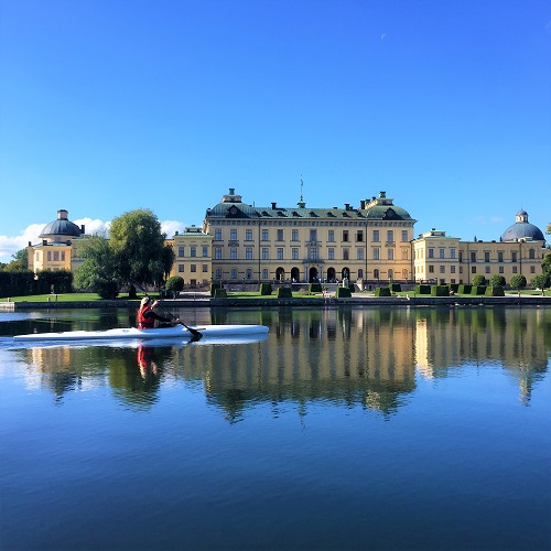 kayaking woman outside royal castle in Sweden