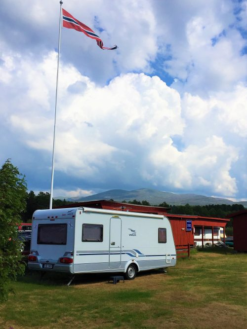 Caravan and Norwegian Flag in Elgå, Norway where Pompe the Traveller Dog went hiking with his mama.