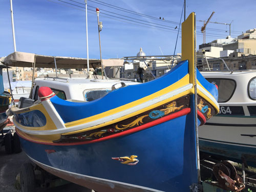 blue traditional boat found when discovering the Maltese coast