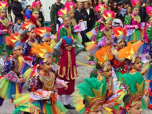 Children in colorful costumes during Carnival on Malta