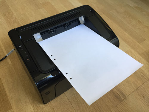 printer with white pater in it